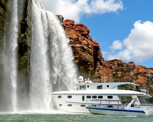 Kimberley Quest under a waterfall
