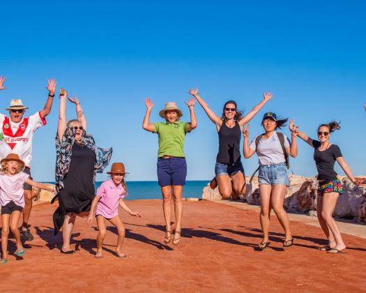 Broome and Around Town Tour jumping for joy at Town Beach Broome, Day Tour, Broome Western Australia