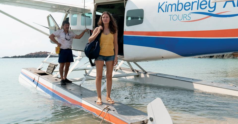 Chugger (Syd Brisbane) and Georgie Jutland (Kelly Macdonald) at the seaplane in DIRT MUSIC. Image: Pelgo (Dirt Music) Pty Limited and Wildgaze Films (Dirt Music) Limited