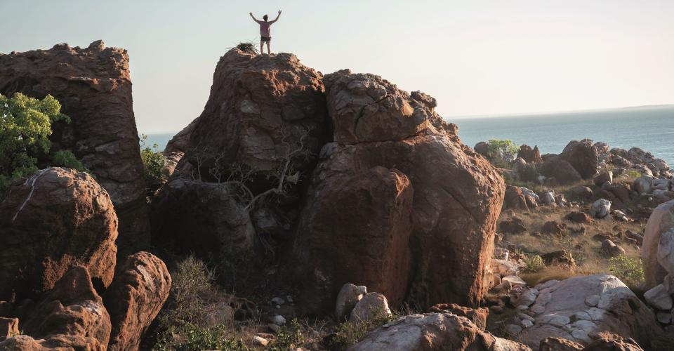 Lu Fox (Garrett Hedlund) standing on rocks in Coronation Gulf, DIRT MUSIC. Location: Dampier Peninsula, Bardi Jawi Country. Image: Pelgo (Dirt Music) Pty Limited and Wildgaze Films (Dirt Music) Limited