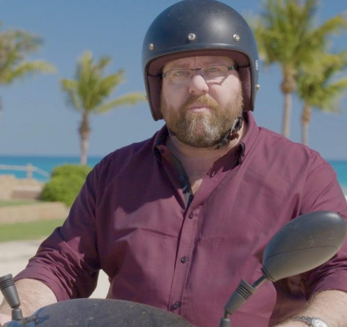 Shane Jacobson on scooter at Cable Beach