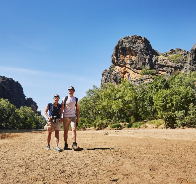 Couple walking in Windjana Gorge. Image: Tourism Western Australia