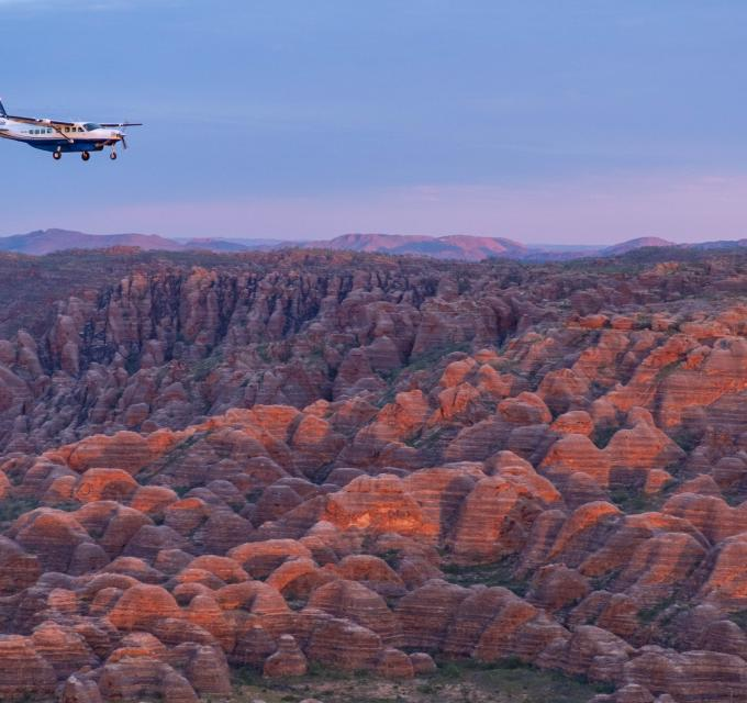 Aviair flying over the Bungle Bungle Range. Image: Kimberley Experiences
