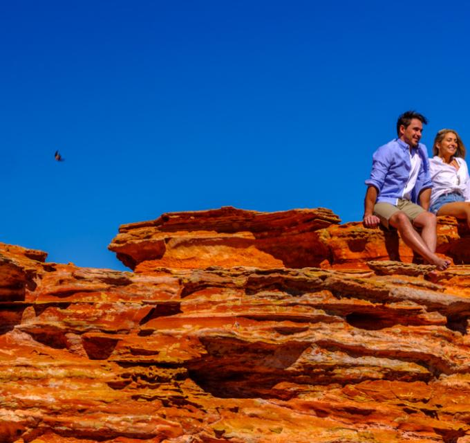 Couple on rocks at Gantheaume Point. Image: Australia's North West.